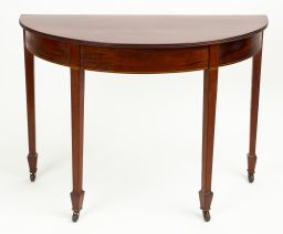 Sale 9150J - Lot 16 - A pair of George III English demi-lune mahogany console tables C: 1805, each reed edge top raised on a boxwood strung frieze to 4 ta...