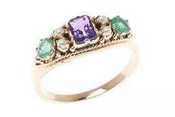 Sale 9213 - Lot 351 - A SUFFRAGETTE INSPIRED GEMSTONE RING; set across the top with a step cut amethyst, 4 seed pearls and 2 round cut emeralds in 9ct gol...