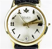 Sale 8402W - Lot 51 - GRUEN PRECISION 14CT GOLD MASONIC WRISTWATCH; sunburst dial with centre seconds, date, gold Masonic hour symbols on a 17 jewell cal....