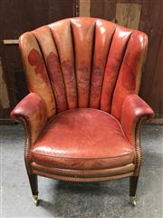 Sale 8699A - Lot 713 - Georgian Style Wingback Armchair in tan leather with brass studded trim and castors, height 105cm