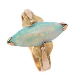 Sale 9107J - Lot 356 - AN ANTIQUE 14CT GOLD OPAL RING; featuring a 17 x 6mm navette cabochon crystal opal with good spectral colours (chipped) to Arts and...