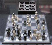 Sale 8709 - Lot 1068 - A black and silver metal chess set together with a noughts and crosses game