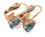 Sale 9066 - Lot 364 - A PAIR OF 14CT GOLD TOPAZ EARRINGS; each set with an approx. 0.80ct pear cut blue topaz on a fancy lever back fitting, length 13mm,...
