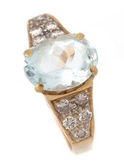 Sale 9107J - Lot 309 - AN 18CT GOLD AQUAMARINE AND DIAMOND RING; 4 claw set with an oval cut pale aquamarine of approx. 2ct (abraded) to shoulders set with...