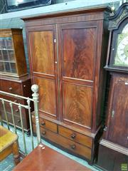 Sale 8598 - Lot 1059 - Early 19th Century Mahogany Gentlemans Press, with two large panel doors enclosing hanging, on a low base fitted with three drawers...