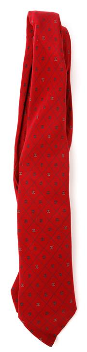 Sale 9080F - Lot 56 - A CHANEL100% SILK TIE; in red with repeating logo all over and chanel embroided