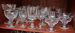 Sale 9098H - Lot 64 - A shelf lot of cut and etched glass to include coupes and etched drinking glasses.