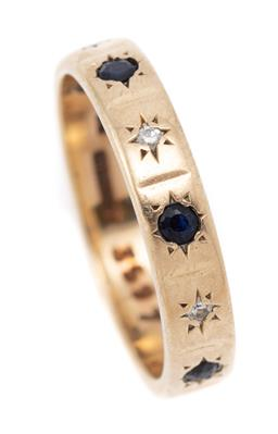 Sale 9107J - Lot 357 - A VINTAGE 9CT GOLD STONE SET RING; 3.5mm wide band star set with 4 round cut sapphires (worn) and 3 single cut diamonds, hallmarked...