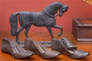 Sale 8625A - Lot 22 - A vintage horse form heavy guage door stop, length 28cm, together with three iron shoe lasts/door stops.