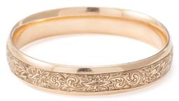 Sale 9124 - Lot 346 - A VINTAGE GOLD PLATED BANGLE; 13.6mm wide hinged bangle, top section with fine scroll and floral engraving, bottom section engraved...