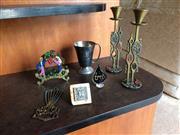 Sale 8313A - Lot 39 - A collection of Judea items, including a menorah, candle sticks, wine cups, serviette holder