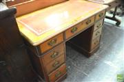 Sale 8335 - Lot 1065 - Victorian Walnut Desk, with tooled russet leather top & nine drawers