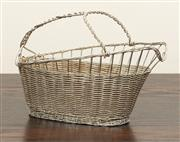 Sale 8871H - Lot 195 - An intricately woven silverplate wine bottle basket, C: Mid 1900s, Height  18cm x Length  27cm