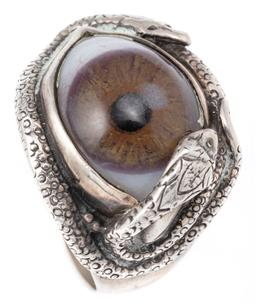 Sale 9124 - Lot 376 - A HALLMARKED STERLING SILVER SNAKE EYE RING; featuring twin snakes wrapped around a glass eye (ware), hallmarked London 1988, size S...