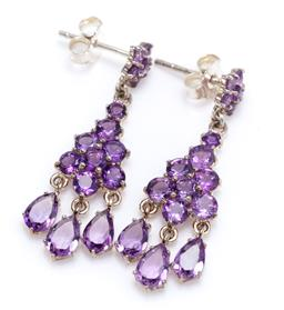 Sale 9213 - Lot 388 - A PAIR OF AMETHYST CHANDELIER EARRINGS; articulated silver drops set with round cut amethyst to fringe of pear cut amethyst, with st...