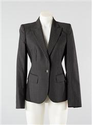 Sale 8740F - Lot 35 - An Alexander McQueen tailored pinstripe blazer, presumably wool and approx size 6/8