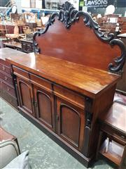Sale 8774 - Lot 1085 - Late 19th Century Cedar Sideboard, with carved back, above three drawers & three arched panel doors