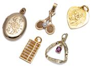 Sale 9037 - Lot 309 - FIVE GOLD PENDANTS/ CHARMS; 23ct lucky heart and abacus, total wt. 3.92g, 14ct crossed tennis racquets set with a cultured pearl, ru...