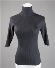 Sale 8499A - Lot 16 - A Bruno Cucinelli (Italy) black designer cashmere & silk short-sleeved turtle neck jumper. Size: S.