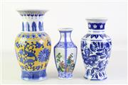 Sale 8905S - Lot 637 - A set of three modern Chinese vases, tallest 27cm