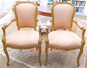 Sale 8800 - Lot 72 - Four Louis XV style gilt armchairs, upholstered in pastel peach fabric