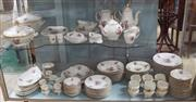 Sale 8320 - Lot 605 - An extensive porcelain dinner, tea and coffee service in the manner of Meissen. Transfer printed with colourful flower sprays and ed...