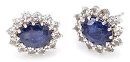 Sale 9160 - Lot 328 - A PAIR OF SAPPHIRE AND TOPAZ CLUSTER STUD EARRINGS; set in silver with oval cut treated blue sapphires surrounded by round cut white...