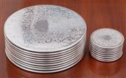 Sale 8908H - Lot 59 - A set of Strachan ten dinner plateS and ten bottle coasters, diameter of larger 20cm