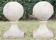 Sale 8422A - Lot 61 - A pair of stoneware spheres raised on tapered square bases, each height 60cm