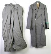 Sale 8952M - Lot 668 - East German Overcoat Together With Large Raincoats (2) And A German Camouflage shirt
