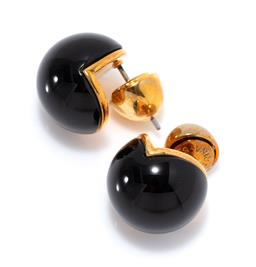 Sale 9213 - Lot 334 - A PAIR OF SARINA SURIANO CAVA ONYX STUD EARRINGS; 14mm round 3/4 onyx spheres in 18ct gold plate, w. 9.17g, new in box with care card.