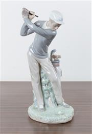 Sale 8486A - Lot 26 - A Lladro figure of a golfer, damage to club, H 28cm