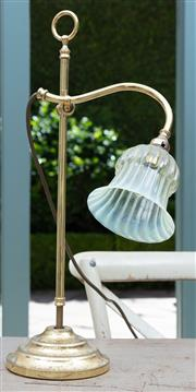 Sale 8866H - Lot 84 - A green vaseline glass and brass desk lamp on circular base.