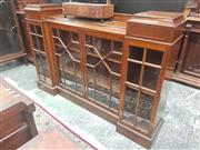 Sale 8917 - Lot 1030 - Pair of Edwardian Maple Dwarf Breakfront Bookcases, with raised pedestal sections, fours astragal doors & plinth bases.