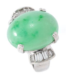 Sale 9169 - Lot 399 - AN 18CT WHITE GOLD JADE AND DIAMOND RING; centring a 15.8 x 13mm oval cabochon variegated green jade to shoulders channel set with 1...