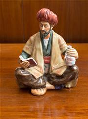 Sale 8313A - Lot 46 - A Royal Doulton figure of Omar Khayyam, HN 2247, height 16cm