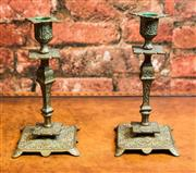 Sale 8420A - Lot 86 - A pair of vintage aged brass candlestick holders, measurements 21cm high x 14cm (base)