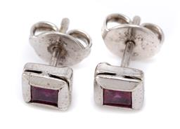 Sale 9107J - Lot 338 - A PAIR OF WHITE GOLD SOLITAIRE RUBY STUD EARRINGS; bezel set with carre cut treated rubies set in 7ct white gold, size 6.3 x 6.3mm,...