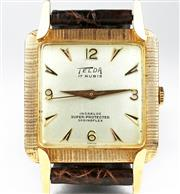Sale 8402W - Lot 52 - TELDA 18CT PINK GOLD WRISTWATCH; matte dial with applied markers centre seconds in a square case with guilloche surround and fancy l...