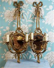 Sale 8500A - Lot 4 - A unique pair of French Style bronze 2 light mirrored wall sconces, featuring beautiful ornate detailed and original bevelled glass...