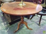 Sale 8539 - Lot 1068 - 19th Century Mahogany Wine Table with Tilt Top and Turned Pedestal