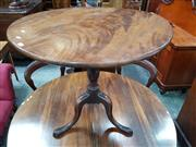 Sale 8848 - Lot 1072 - Late Georgian Mahogany Wine Table, with circular tilt-top, turned pedestal & outswept feet
