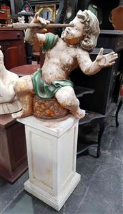 Sale 8925 - Lot 1096 - A vintage painted figure of a musical cherub on a jardiniere stand