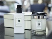 Sale 8709 - Lot 1076 - A boxed set of Jo Malone pomegranate noir scented candle, body and hand lotion 250mL, height of candle 6.35cm