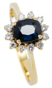 Sale 9046 - Lot 316 - A 10CT GOLD SAPPHIRE AND DIAMOND CLUSTER RING; centring a blue oval cut sapphire of approx. 0.82ct surrounded by 12 round brilliant...