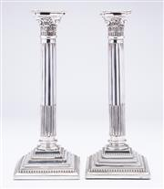 Sale 9015J - Lot 97 - A pair of large antique English silverplate corinthian columncandle sticks, C: 1890s, the reeded and fluted columns raised on a squ...