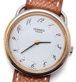 Sale 9160 - Lot 371 - AN HERMES ARCEAU QUARTZ WRISTWATCH; ref; 79781 with white dial, Arabic numerals, gold plated bezel, stainless steel case, diam. 30mm...