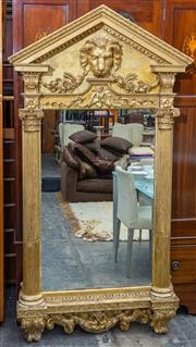 Sale 8746 - Lot 1022 - A George II style antique gilt pier mirror, the open tympanum top with lion mask and festoons, supported by Corinthian half columns...