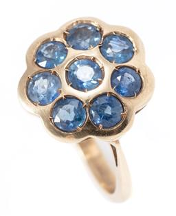 Sale 9169 - Lot 356 - A 9CT GOLD SAPPHIRE RING; daisy cluster rub set with 8 round cut blue sapphires totalling approx. 2.00ct, top 16 x 16mm, size M, wt....