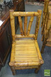 Sale 8412 - Lot 1077 - Set of Six Bamboo Chairs with Lattice Design to Side